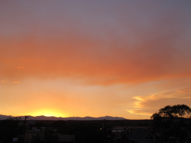 I finally found a place to watch the sun set in Santa Fe, on the top floor of the parking deck near my B&B. The colors and clouds were beautiful.