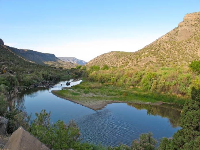 I drove from Taos through the Santa Fe National Forest. This tributary of the Rio Grande was still and beautiful, reflecting the early morning light.