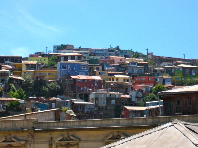Colorful houses line the hillsdie