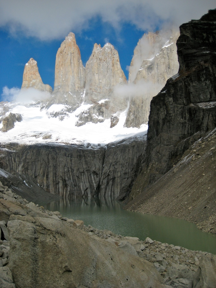 "Los Torres del Paine [The Towers of ""Paine"" is a Tehuelche Indian word meaning blue.]"